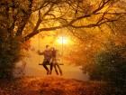 Loving couple swinging in autumn park