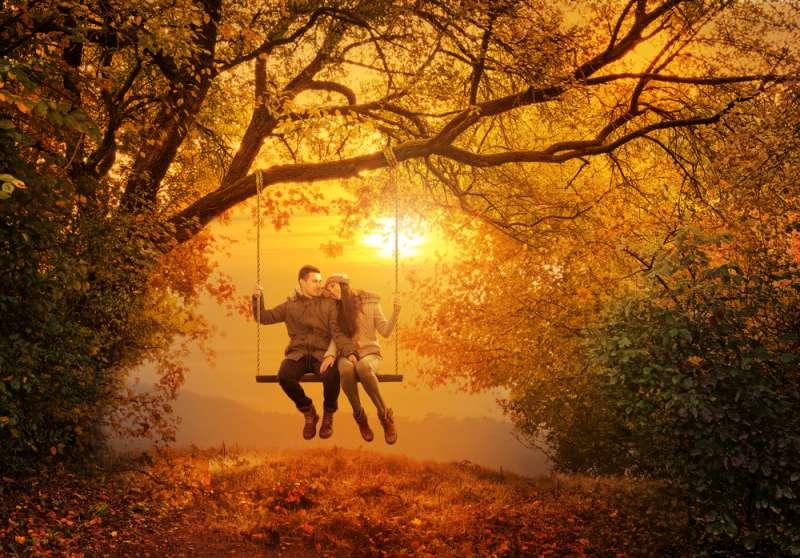 Loving couple on swing